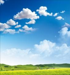 蓝天白云草原绿地远山背景素材